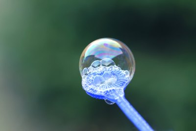The player who pops the most bubbles before they hit the floor is the winner.