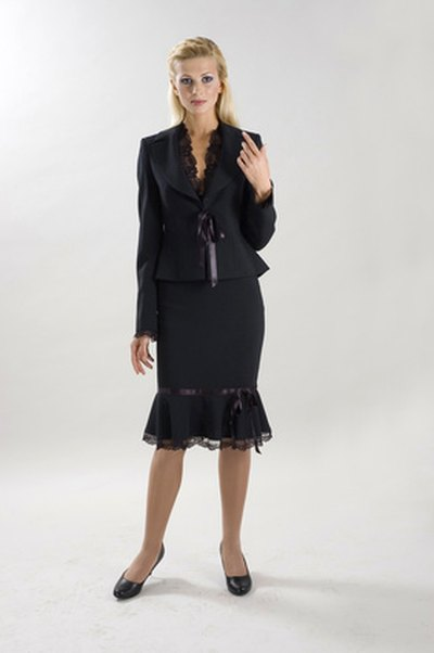 A skirted suit is the most professional choice for women.