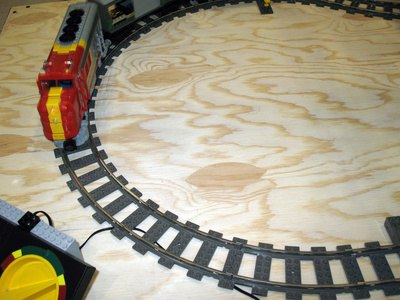Attach the train track with a screw driver and screws.