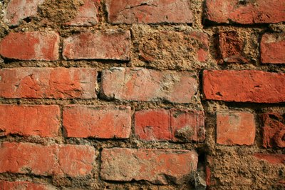 Replace any badly damaged bricks.