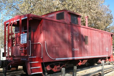 The #3 Engine pulls an authentic wooden caboose.