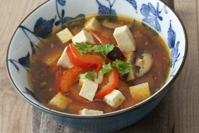 An asian style soup with tofu.