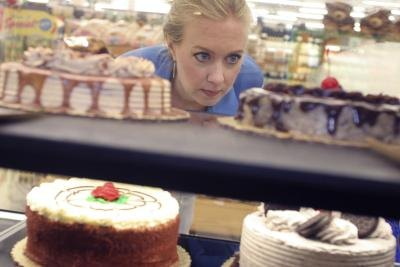 Woman looking at cakes