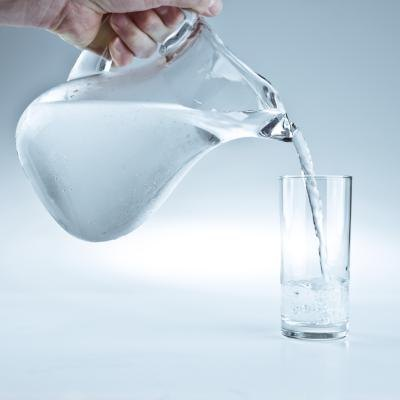 Pitcher of water pouring into a glass.