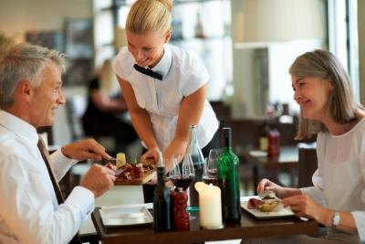Waitress attending to customers