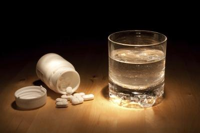 Ibuprofen with a glass of water.