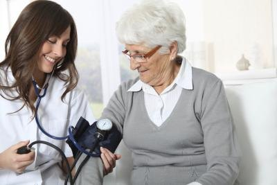Senior woman gets blood pressure test