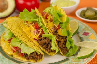 Plate of tacos with lime wedges