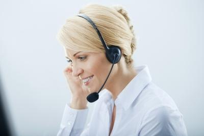 Some customer service representatives speak on a headset.