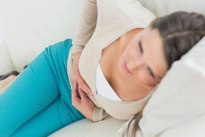 Woman resting on couch after spasm