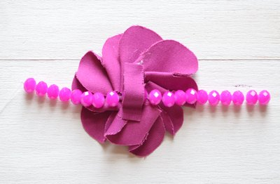 Connect the beaded string and fabric flower.
