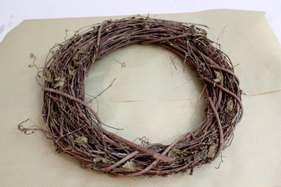 Start with a grapevine wreath form available at craft stores.