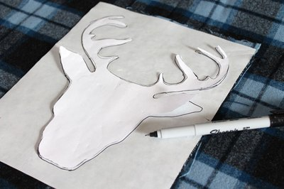 Trace the pattern onto the adhesive paper.