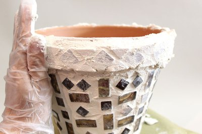 The grout can stop at the top of the rim.