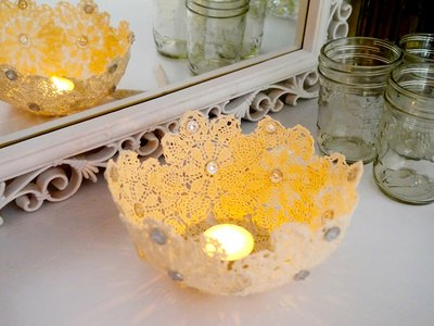 A lace candle holder will set an elegant mood.