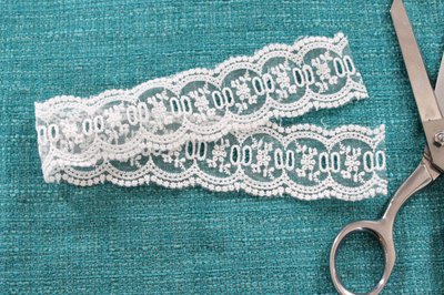 Cut the lace with a pair of sharp scissors.