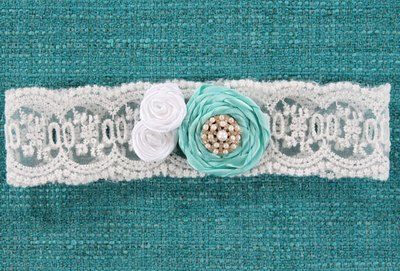 Lace bridal garter with a blue fabric flower