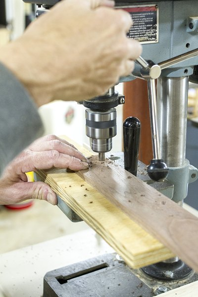 Drill holes into the brace using a drill press.