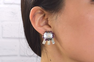 Use clear plastic food packaging as a base for your next set of earrings.