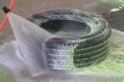 A pressure wash cleans the tire of road grime.
