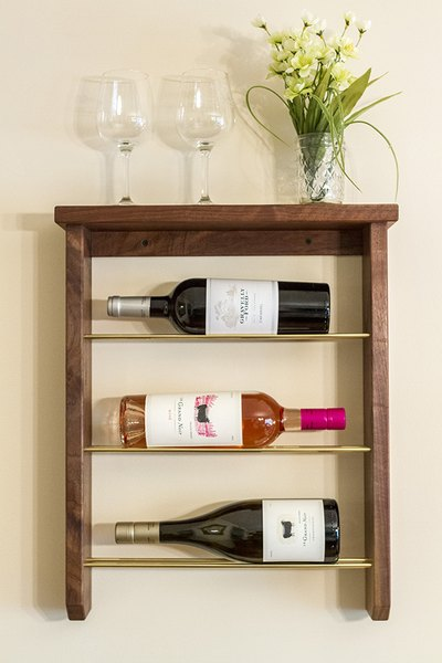Make your own DIY wall-mounted rack to display wine bottles.