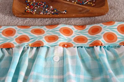 Pin the apron into the waistband.
