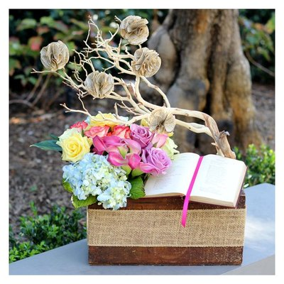 This centerpiece is perfect for a vintage or literary-themed event or room.
