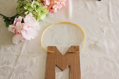 Cut a piece of ribbon to hang your letter.