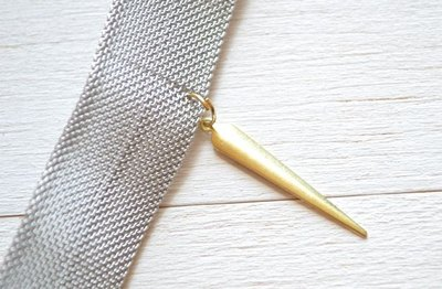 Close a jump ring by bending the ends towards each other.