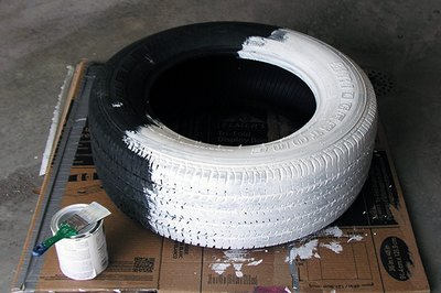 Prime and paint the tire on both sides.