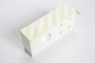 Give the block a bit of added personality by creating a design on the side with masking tape.