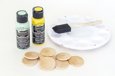 Paint two sets of wooden craft store discs in coordinating accent colors.
