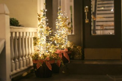 Enjoy the holiday glow from these DIY topiaries.
