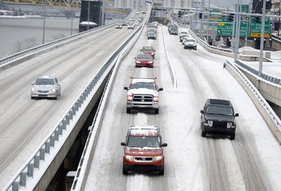 Commuters on snow-covered highway in Pittsburgh
