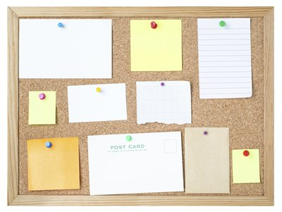 Common school glue adheres many materials to corkboard.