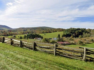 A pasture with a fence in the pasture.