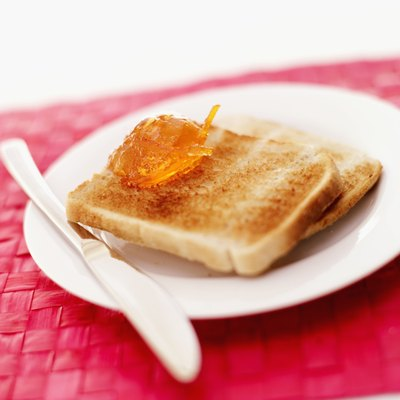 Two pieces of toast on a plate.