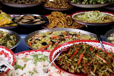 Plates of ethnic dishes on a table.