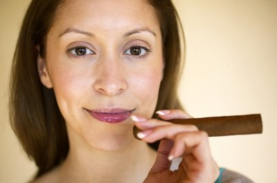 woman holding a cigar