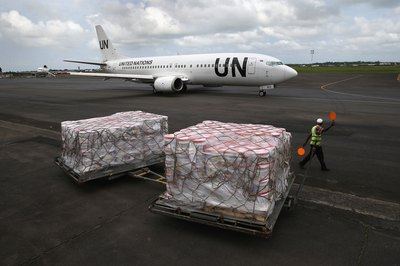 A government shipment is delivered at an airport.