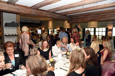 Women networking at a luncheon.