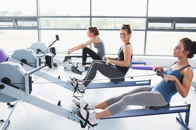 Women exercising on rowing machines