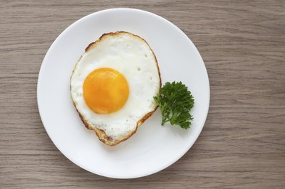 Cooked egg on a small plate.