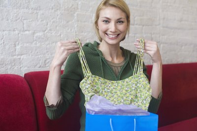 Woman opening gift