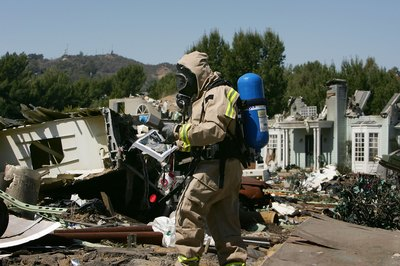 A man evaluates the levels of hazardous materials in a neighborhood after an earthquake.