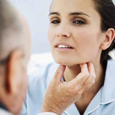A doctor checks a womans throat for obstructions..