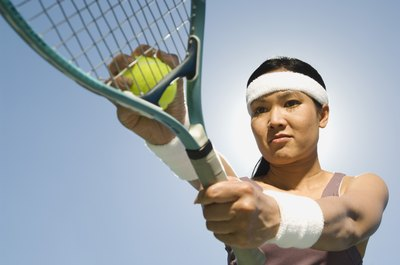 Female tennis player with headband.