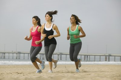 women running on a beach