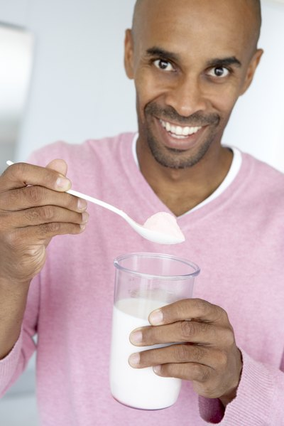 Man adding meal replacement powder to drink