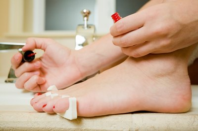 Similar to painting your toe nails, use toe separators to help keep your toes from curling towards the center